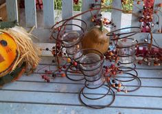 repurposed rusty bed springs into votive candle holders