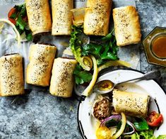 Lentil sausage rolls with tomato sumac salad recipe - By Australian Women's Weekly, Reinvent a childhood favourite with these lentil sausage rolls with tomato sumac salad - tasty, wholesome and completely meat free!