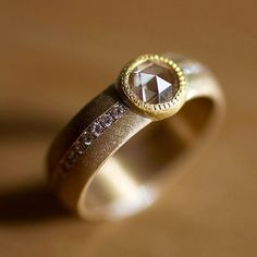 elizabethstreetjewelry .7ct rose cut champagne diamond set in 22k with a nice wide band.