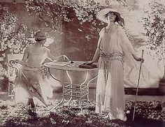 Baron Adolphe de Meyer. Fashion Study, two models at a table 1920
