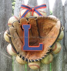 The Original Baseball Wreath - With Glove.  Here's a cute idea, use your sons first glove, and give to them for their first housewarming gift