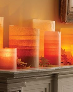 fall luminary mantel, tissue paper wrapped around jars, candle inside
