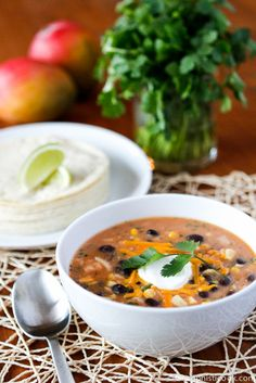 Easy Chicken Tortilla Soup -- this easy chicken tortilla soup, made in your slow cooker, is creamy and flavorful. Perfect for a cold, winter evening!