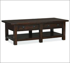 Benchwright Coffee Table with rustic mahogany stain from Pottery Barn.  I like the drawers for remote storage.