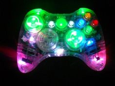 color changing LED xbox modded controller -- what about play station two? Manette Xbox 360, Consoles, Wii, Fun Video Games, Xbox 360 Controller, Xbox Console, Gamer Humor, Nintendo, Toys