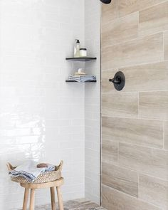 Mixing different tile materials, sizes, and shapes creates a dynamic design you'll never stop swooning over.🥰  Ready for a refresh? Schedule a design consultation today! Learn more at the link in bio.  Tiles featured: Retro Perla, Albero Argent, Latta Hex, + Dark Stainless Steel Somerset. Faux Wood Tiles, Wood Look Tile, Ceramic Subway Tile, The Tile Shop, Bathroom Tile Designs, Dynamic Design, Modern Farmhouse Style, Wall And Floor Tiles, Walk In Shower