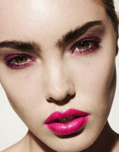 Bright pink lips.