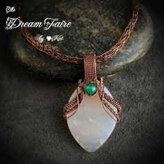 White Crab Agate and Copper Pendant and Chain  A beautiful white dragon scale clutched by copper talons holds a baleful green eye.  ABOUT THIS ITEM  • I chose a smooth, leaf shaped crab agate gemstone measuring 30mm X 45mm and a 6mm round agate in ocean green, combined with pure copper wire...