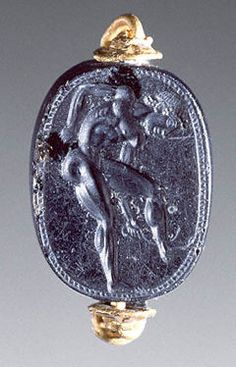 Youth Scraping His Leg with a Strigil, attributed to Epimenes, about 500 B.C. Obsidian scaraboid intaglio set in a modern gold ring, 5/8 x 1/2 x 1/4 in. The J. Paul Getty Museum, 85.AN.370.6