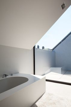 """House CM is a contemporary terraced house wrapped in timber-cladding  """"Cut out roof"""" - #tforia"""