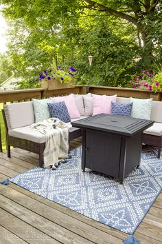 This blue and white outdoor rug works beautifully in this outdoor seating area on a small deck small deck decorating ideas Deck Decorating Ideas On A Budget, Outdoor Deck Decorating, Patio Decorating Ideas On A Budget, Patio Ideas, Porch Decorating, Backyard Ideas, Small Deck Ideas On A Budget, Decking Ideas, Decor Ideas