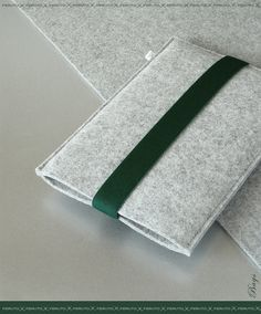 Our ARCHITECT sleeve is designed with a focus on high comfort and functionality that makes your Mini iPad feel comfortable and beautiful at the same time.  ARCHITECT is made of high quality german wool felt. German woolen felt is known for its best quality. It is eco-friendly, long-lasting, breathable, water-repellent and stain-resistant by nature.  Its stylish dark green colored elastic band offers a quick and easy way to keep your iPad Mini safe and in place.  Materials used:  outer…