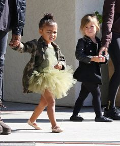 Two peas in a pod: North, two, looked too cute in her tutu while Penelope, three, looked ballerina chic in black tights, ballet slippers and black coat