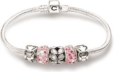 Chamilia - A new favorite thing because my husband and children bought me a bracelet with charms for Mother's Day.
