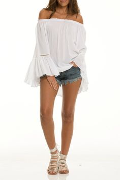 White off the shoulders tunic with ruffled sleeves.       Ruffle Sleeve Tunic by Beth Friedman. Clothing - Tops - Casual Clothing - Tops - Tunics Clothing - Tops - Off The Shoulder Arizona