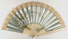 Fan French Late 19th century Medium: Hand-painted silk satin with lace; ivory sticks; silver loop