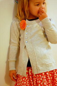 Dad's sweater upcycled into girl's cardigan--tutorial is at http://hungiegungie.com/2011/10/11/upcycled-dads-sweater-into-girls-cardigan-kcwc-day-2/