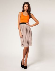 ASOS PETITE Pleated Skirt Color Block Dress $60 Block color dress by ASOS PETITE, featuring a scooped neckline and sleeveless styling with a wide stretch waistband and full pleated skirt in a bold color contrast paneled design and soft fluid finish.