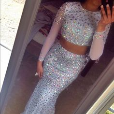 Jovani white long sleeve backless 2 piece prom Beautiful two piece Jovani long sleeve prom dress only work once, in perfect condition! no missing diamonds or jewels or stains, size 2 but I'm a 27 in the waist which is normally a 4/6 and it stretches and fit me like a glove! Jovani Dresses Long Sleeve