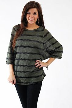 """The Marli Top, Olive $37.00  We love this comfy top! The dolman sleeves, horizontal stripes and loose knit all combine flawlessly to create this trendy top! We have a feeling this will quickly climb the ranks of your favorite articles of clothing!   Fits true to size. Miranda is wearing a small.   From shoulder to hem:  Small - 27.5""""  Medium - 28.5""""  Large - 29.5"""""""