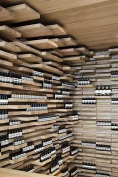 Planks of Australian Ash, stacked as in a timber yard, Paris Aesop Store.