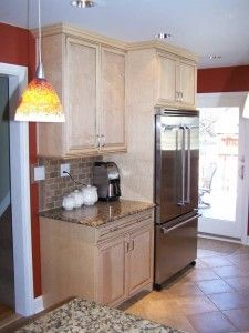 Small Kitchen Design utilizing a counter depth Refrigerator!
