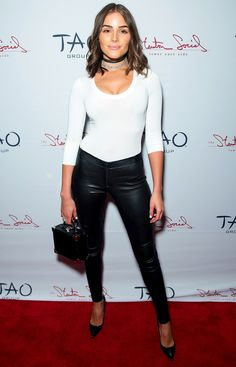 Olivia Culpo in a white T-shirt, black leather pants and two chokers