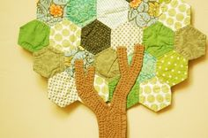 Hexagon tree quilt.  Must use my hexies and make one of these for a cute bag.