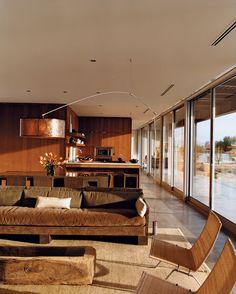 lounge: wicker PK22 lounge chairs by Poul Kjaerholm for Fritz Hansen.