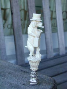 click to view larger image of A Fine and Rare 19th Century Silver Mounted Ivory Desk Seal in the Form of Dog Letter Carrier