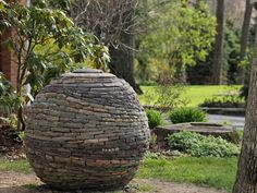 """A ball of living energy, made from multiple colors of stone swirling about,"" is how Devin Devine describes his latest garden art creation"
