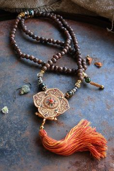 Raktu seed Mala necklace decorated with a by look4treasures