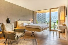 A small designer hotel near Meran in South Tyrol, Hotel Muchele ticks all the boxes of a charming and warm stay. With only 40 suites, you get all the best of an exclusive experience and a calm, easy-going atmosphere. South Tyrol, Hotels Near, Italy, Warm, Ticks, Bed, Inspiration, Furniture, Design