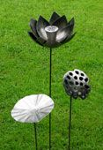 Metal Lotus plant sculpture, hand forged and formed steel. www.ironvein.co.uk  Metal garden sculpture Steel garden sculpture