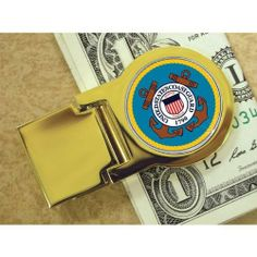 """Goldtone Money Clip with Colorized Coast Guard Washington Quarter by Brookstone. $29.99. Goldtone Money Clip with Colorized Coast Guard Washington Quarter. Goldtone Money Clip with Colorized Coast Guard Washington Quarter. This useful and classic goldtone money clip features a Washington Quarter beautifully colorized with the Coast Guard emblem. Does not include currency. Certificate of Authenticity included. Dimensions: 2.25"""" L x 1.25"""" W x .38"""" H Weight: 0.1875 lbs."""