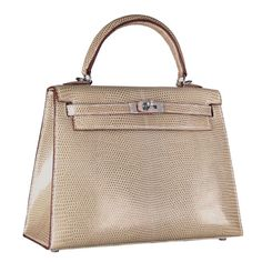 Hermes Kelly 25cm in lizard with silver hardware. Oh, yes!