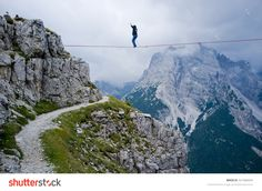"Monte Piana, Dolomites/Italy - September 08, 2013: An Acrobat On A Rope Tended Above An Abyss During ""Highline Meeting"" Of Tightrope Walkers From Around The World Taking Place Every Year On September Stock Photo 321906044 : Shutterstock"