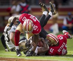 Saints vs. 49ers:  41-23, Saints  -  November 6, 2016  -     New Orleans Saints running back Tim Hightower (34) runs in for touchdown defended by San Francisco 49ers cornerback Jimmie Ward (25) and San Francisco 49ers strong safety Antoine Bethea (41) in the first quarter during a game at Levi's Stadium on Sunday, November 6, 2016, in Santa Clara, Calif.