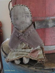 """This little sweetie is made from bits and bobbles of early cloth...calico, wool and love. She has mismatched arms and legs to her old tick body and replaced head. She is stuffed with cloth and a bit of cotton and all hand-stitched. Approx. 7 1/2"""". She is signed and dated. $55 ~includes US priority shipping."""