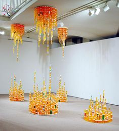 #BeautifullyUpcycled - Artistically stacked empty pill bottles become a glittering cave-like installation.