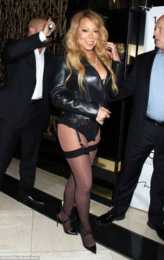 Heel-y good: Mariah elongated her toned pins with a pair of strappy black spiky heels