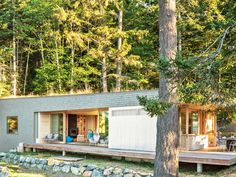 Located on the San Juan Islands in Washington State, this 1,600-square-foot vacation home was built for a family of four who were looking for a serene and nature-focused retreat from their city lifestyle. Designed by Heliotrope Architects and decorated by Ore Studios, the house features a green roof planted with seeds that were foraged from the property to connect the space to the surrounding landscape.