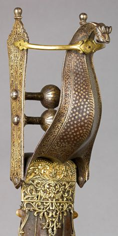 Indian (Vijayanagara) katar, second half 16th century, detail view, steel, silver, gold, leather, shark's teeth ,  L. 30 1/2 in. (77.5 cm), Bequest of George C. Stone, 1935, Met Museum.