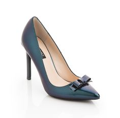 Take your wardrobe into seriously chic territory with this pretty pair. In brilliant hues like teal and rose gold, and topped off with a flirty bow, you'll turn on the charm the moment you slip these pumps on.