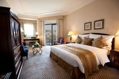 King Classic Nile view Enjoy panoramic views of the River Nile from the private balcony of this spacious, 42 sqm2 guest room at the Conrad Cairo hotel. Unwind in the luxurious bathroom with separate bathtub, walk-in shower and complimentary fragranced amenities.