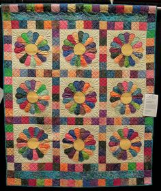 Thoroughly Modern Dresden Plate by Darlene Thomas, quilted by Betty Rudd. Made with colorful batiks. 2013 AZQG. Photo by Quilt Inspiration