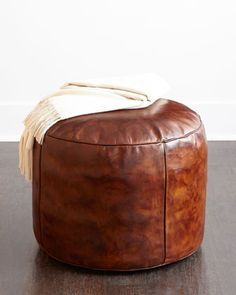 """Handcrafted pouf. Full-grain leather upholstery. Fiber filled. 22""""Dia. x 18""""T. Imported. Boxed weight, approximately 52 lbs."""