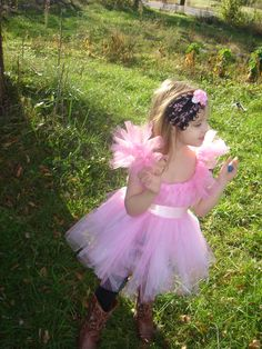 Tutu Dress Top!   My daughter wearing it with her feather pad headband  www,facebook.com/bellarosabows