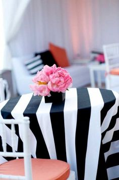 Plush pink peonies pop against a chic black and white striped tablecloth at @Mandy Bryant Bryant Bryant Dewey Seasons Resort The Biltmore Santa Barbara.