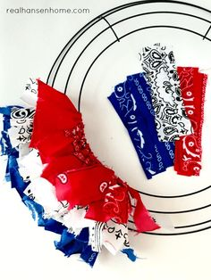 DIY Patriotic Bandana Wreath Patriotic Banana DIY Wreath for memorial day, of July or Flag Day! Easy tutorial on how to make this simple wreath out of supplies from the dollar store. Great red, white and blue decor for your front door. Patriotic Crafts, Patriotic Wreath, July Crafts, Holiday Crafts, Flag Wreath, Heart Wreath, Patriotic Party, Holiday Wreaths, Holiday Ideas